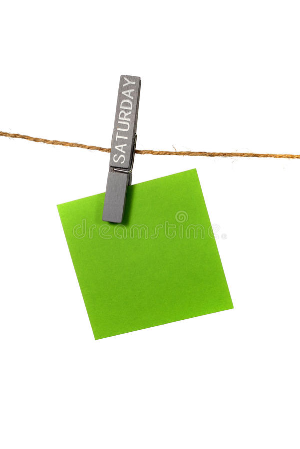 Υπόμνημα Hangin χρώματος με την καρφίτσα υφασμάτων Σαββάτου στοκ εικόνες