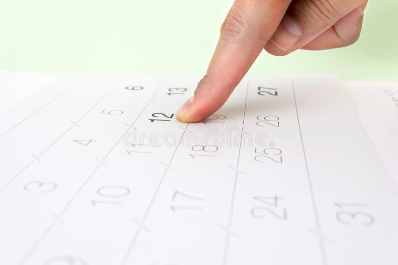 Υπόδειξη της παραπομπής στο ημερολόγιο στοκ εικόνα
