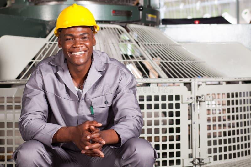 Υφαντικός βιομηχανικός εργάτης στοκ εικόνες