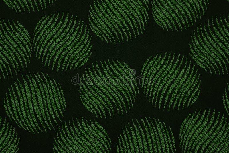 Υλικό στους πράσινους κύκλους, ένα υπόβαθρο στοκ φωτογραφία