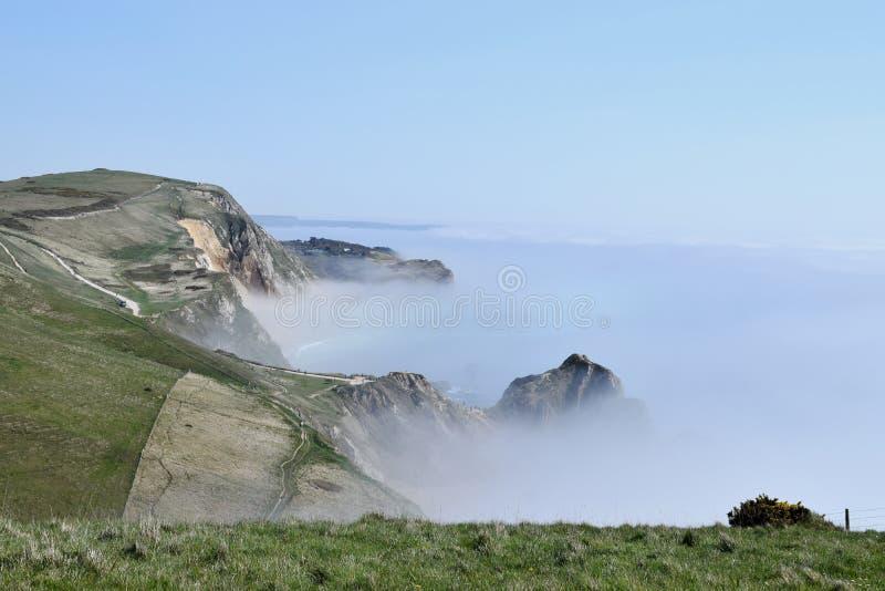 Υδρονέφωση στην ακτή κοντά στον όρμο Lulworth, Dorset στοκ φωτογραφίες