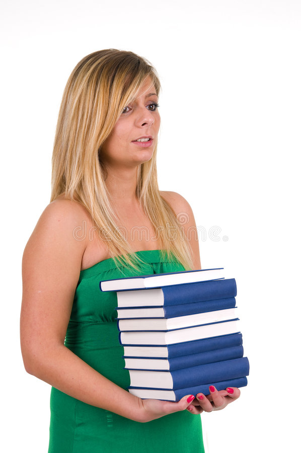 Φέρνοντας βιβλία γυναικών στοκ φωτογραφία με δικαίωμα ελεύθερης χρήσης