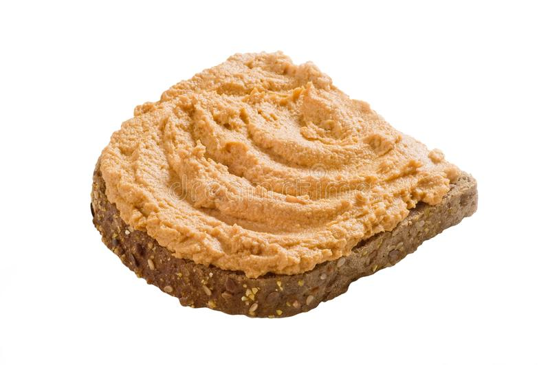 φέτα ψωμιού που διαδίδετ&alpha στοκ φωτογραφία με δικαίωμα ελεύθερης χρήσης