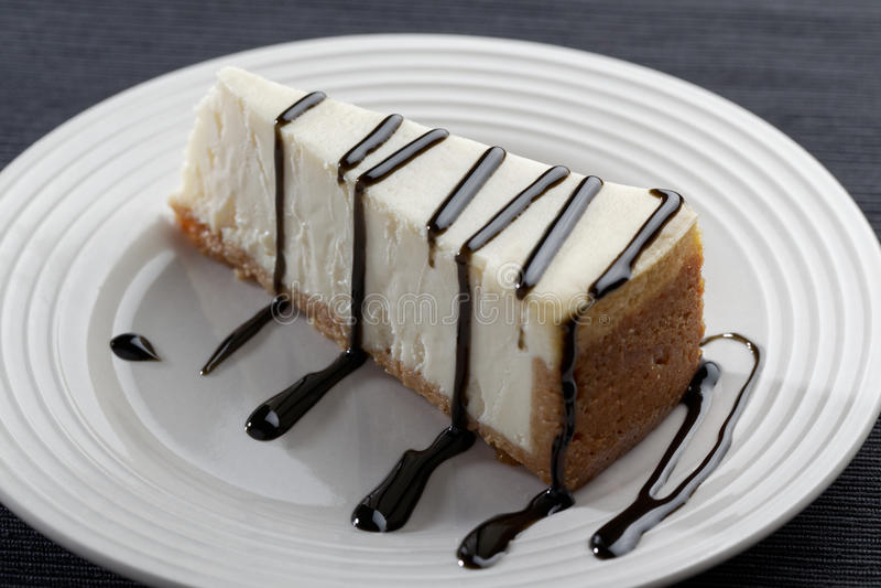 Download Φέτα Cheesecake με Liquorice τη σάλτσα Στοκ Εικόνα - εικόνα από πλάνο, πασπαλίζοντας: 62703385