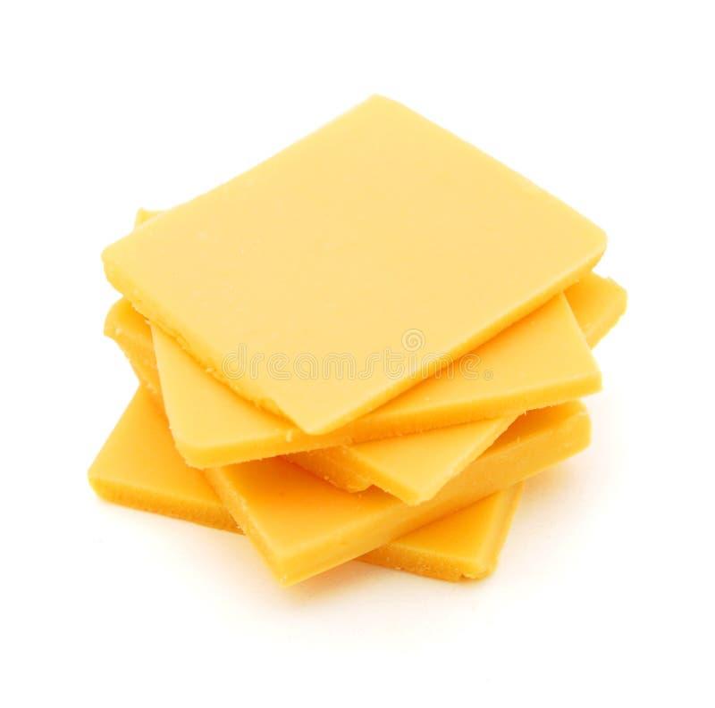 Φέτες τυριών τυριού Cheddar στοκ εικόνα με δικαίωμα ελεύθερης χρήσης