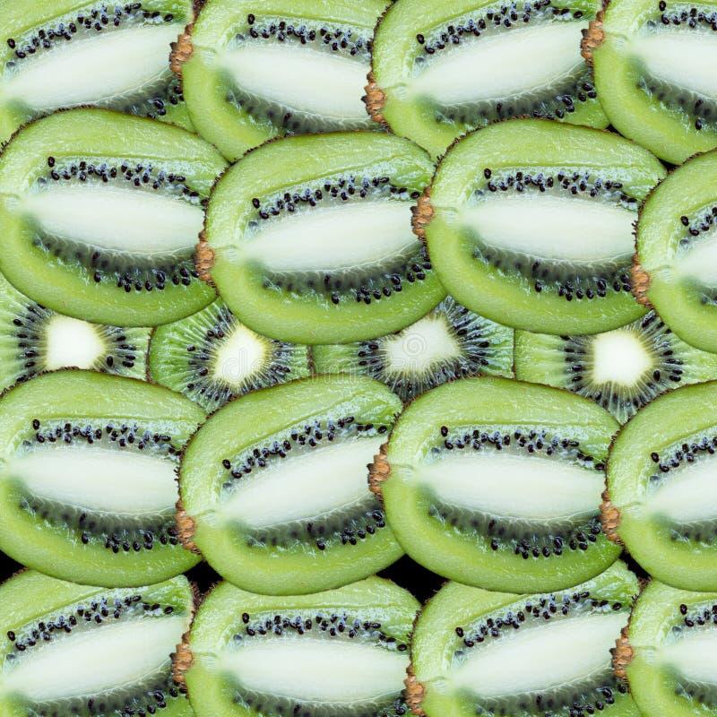 Φέτες φρούτων σε ένα μαύρο υπόβαθρο στοκ εικόνες