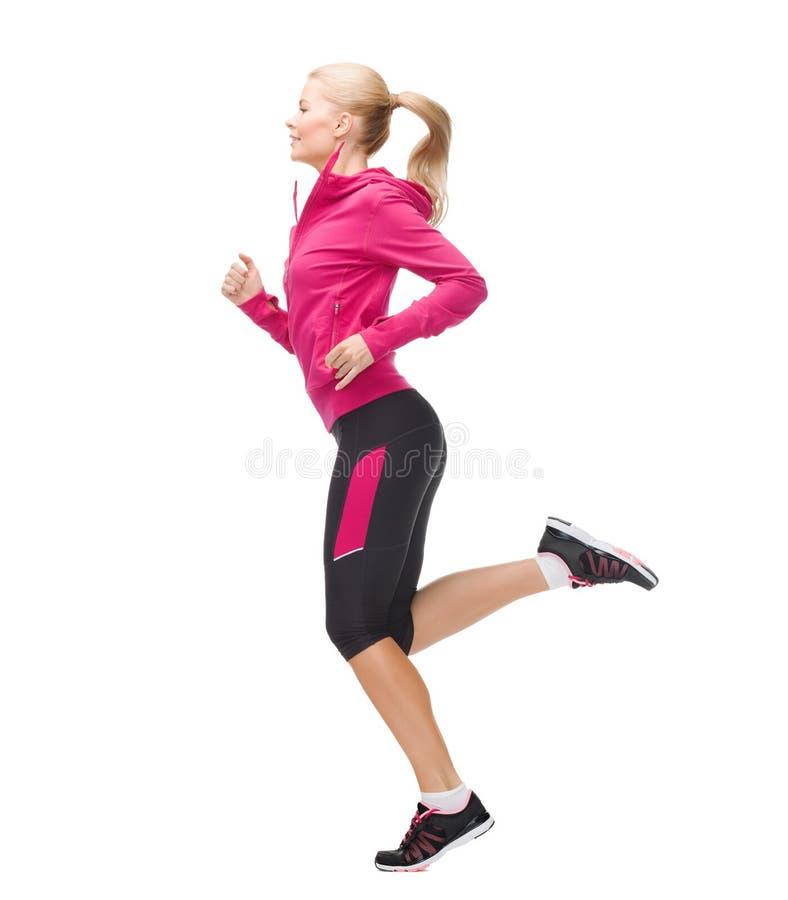 Φίλαθλη γυναίκα που τρέχει ή που πηδά στοκ εικόνες