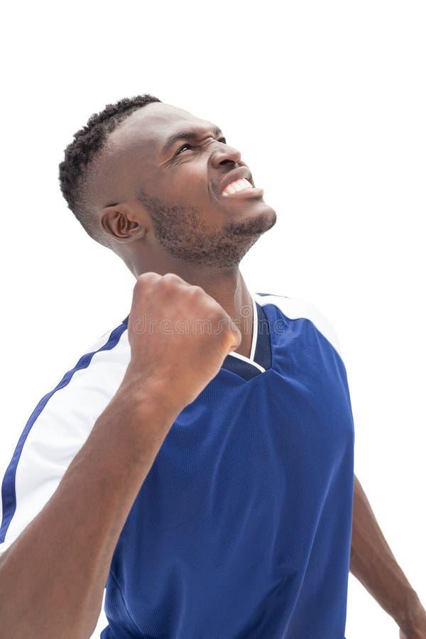 Φίλαθλος ποδοσφαιριστής που ανατρέχει στοκ φωτογραφία με δικαίωμα ελεύθερης χρήσης