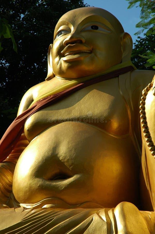 φαλακρό παχύ χαμόγελο του Βούδα στοκ φωτογραφία