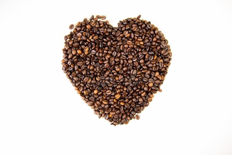 Φασόλια καφέ στη μορφή της τοπ άποψης καρδιών στοκ εικόνες με δικαίωμα ελεύθερης χρήσης