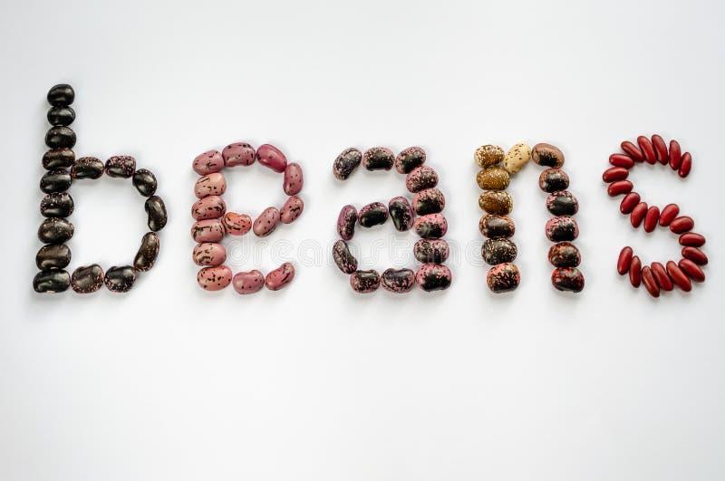 Φασόλια λέξης που σχεδιάζονται από τα ζωηρόχρωμα φασόλια στο άσπρο υπόβαθρο o r στοκ εικόνες με δικαίωμα ελεύθερης χρήσης