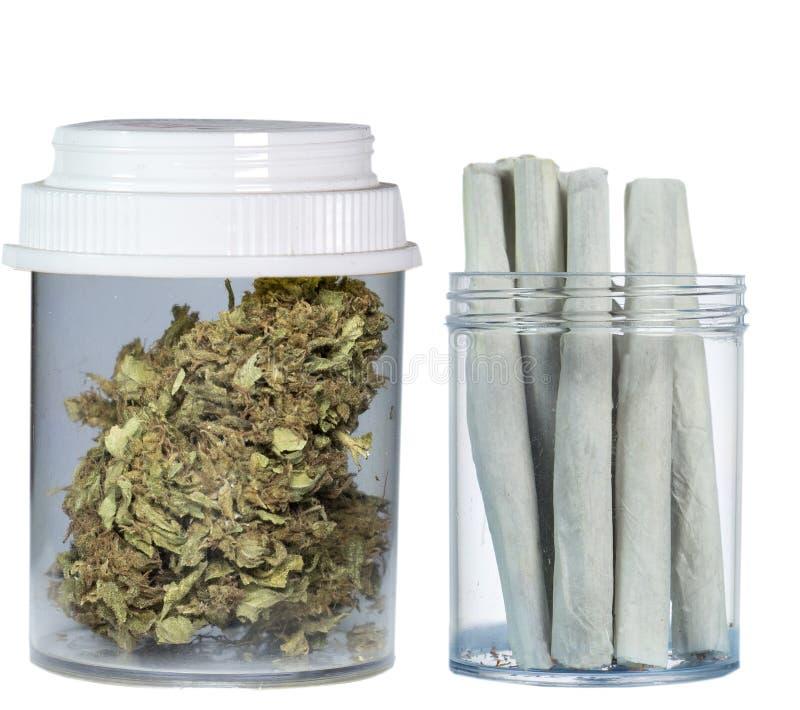 Φιαλίδιο της ιατρικών μαριχουάνα και των τσιγάρων μαριχουάνα στοκ φωτογραφία με δικαίωμα ελεύθερης χρήσης