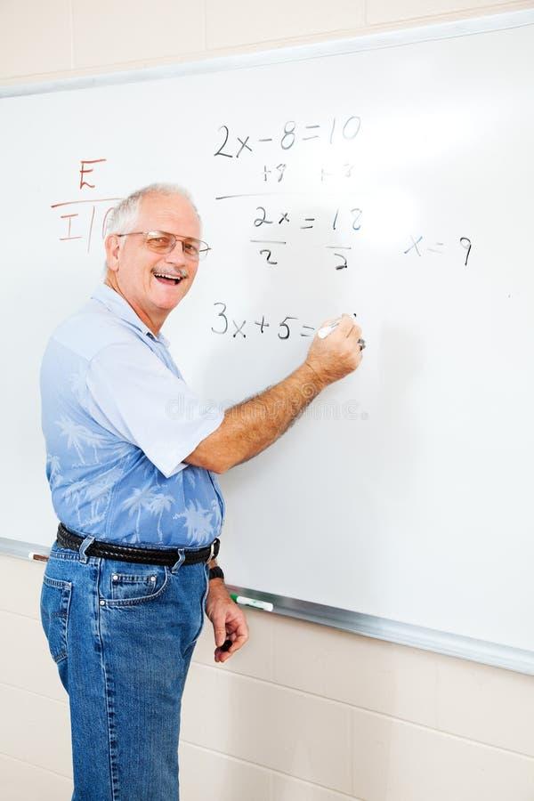 Φιλικός δάσκαλος ή ενήλικος σπουδαστής των ΕΔ στοκ εικόνα