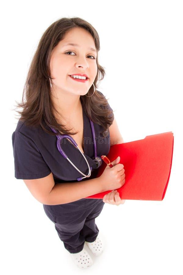 Φιλικός θηλυκός γιατρός που απομονώνεται στο λευκό στοκ εικόνες