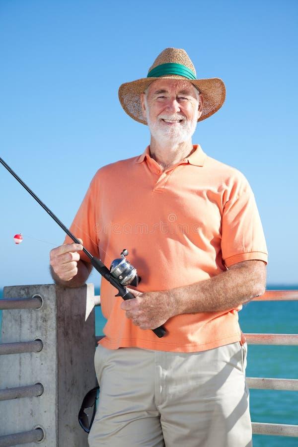 φιλικός πρεσβύτερος ψαρά& στοκ εικόνες