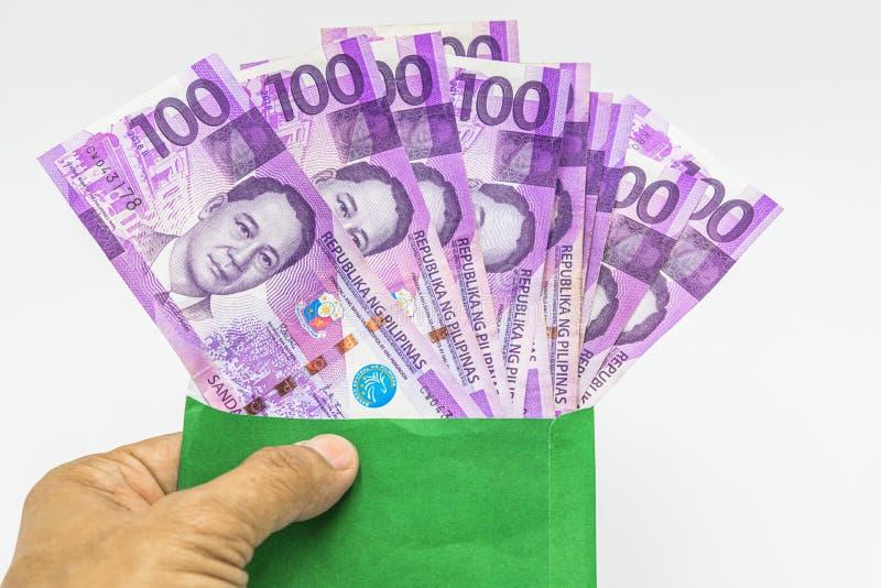 Φιλιππινέζικος λογαριασμός 100 πέσων, νόμισμα χρημάτων των Φιλιππινών, φιλιππινέζικο υπόβαθρο λογαριασμών χρημάτων στοκ εικόνα
