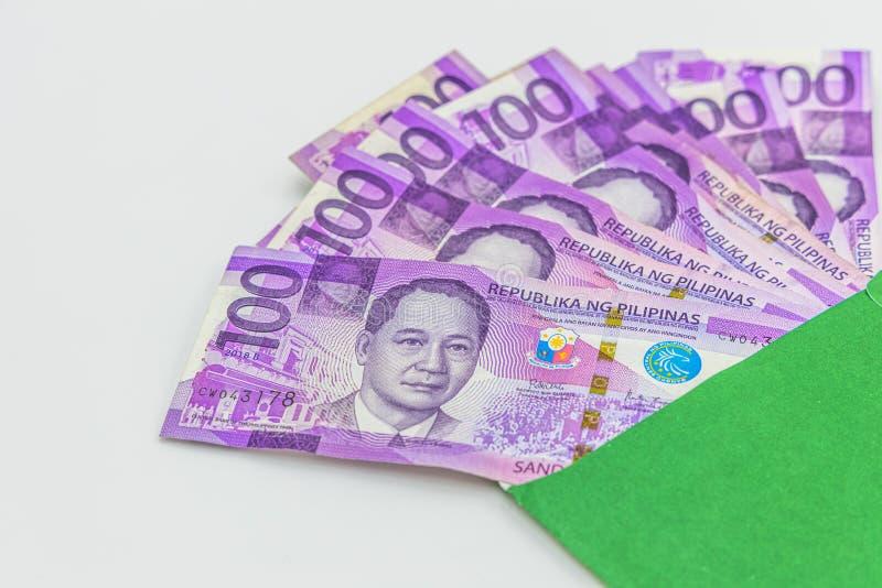 Φιλιππινέζικος λογαριασμός 100 πέσων, νόμισμα χρημάτων των Φιλιππινών, φιλιππινέζικο υπόβαθρο λογαριασμών χρημάτων στοκ φωτογραφίες