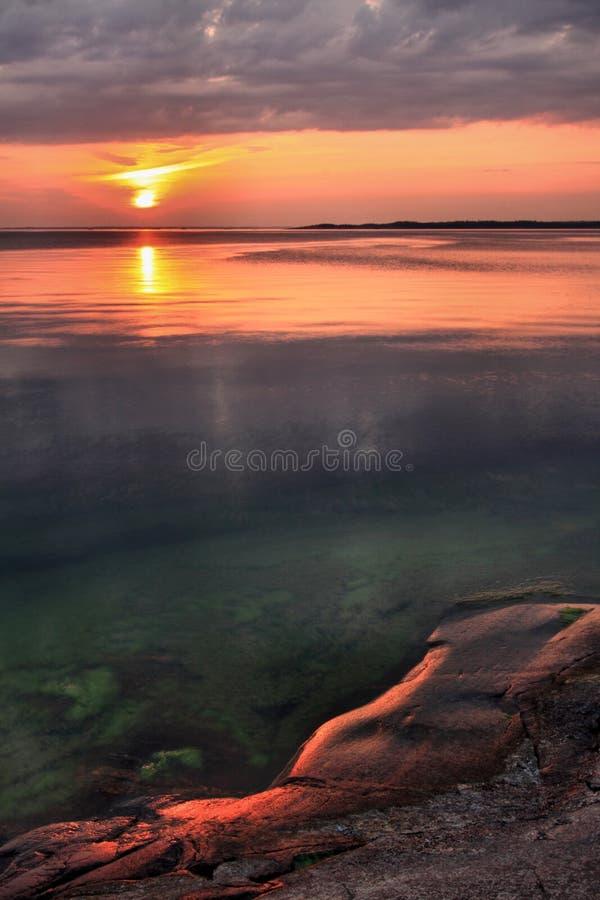 Φινλανδία: Ηλιοβασίλεμα στη νότια ακτή στοκ φωτογραφίες