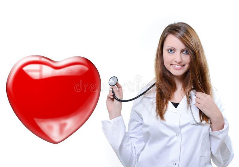 Φιλικός θηλυκός κτύπος της καρδιάς ακούσματος γιατρών στοκ εικόνα