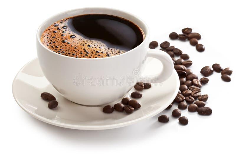 Φλυτζάνι και φασόλια καφέ στοκ εικόνα με δικαίωμα ελεύθερης χρήσης