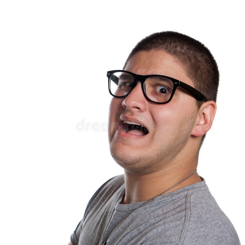 Φοβησμένος εφηβικός νεαρός άνδρας στοκ εικόνα