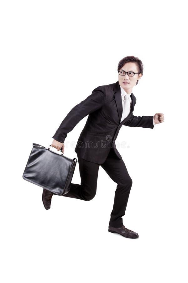 φοβισμένο μακριά τρέξιμο επιχειρηματιών στοκ εικόνες