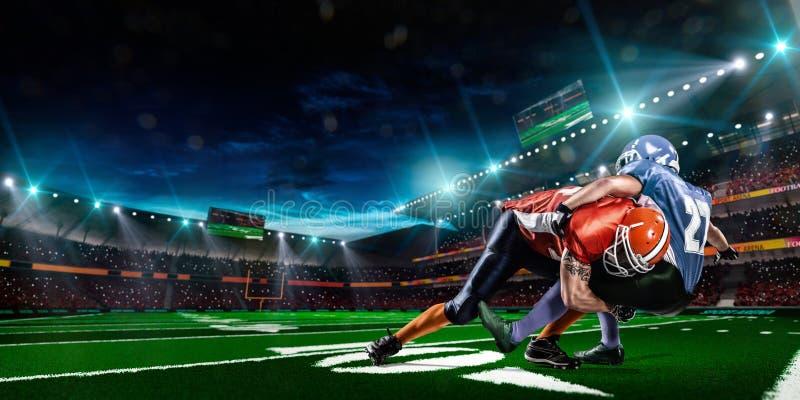 Φορέας αμερικανικού ποδοσφαίρου στη δράση στο στάδιο στοκ φωτογραφίες