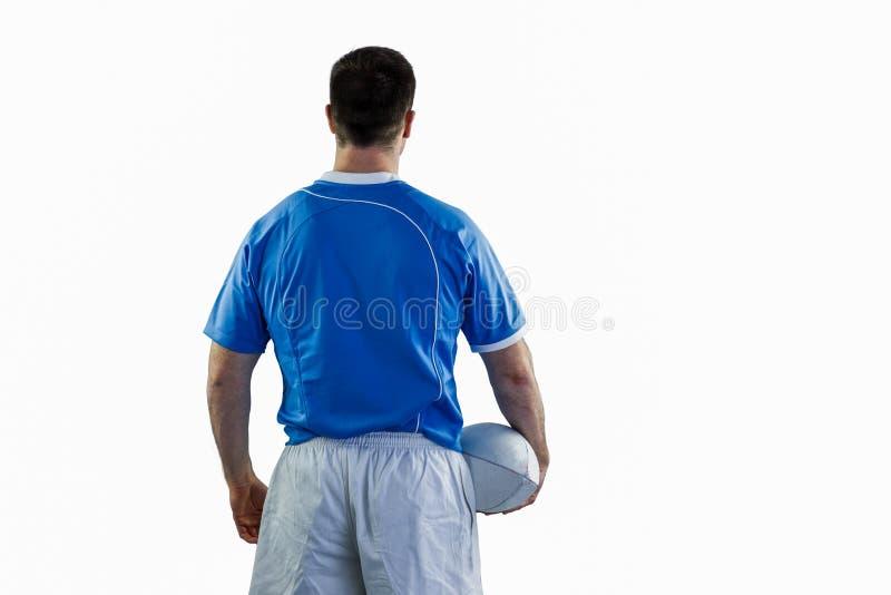 Φορέας ράγκμπι που κρατά μια σφαίρα ράγκμπι στοκ εικόνες