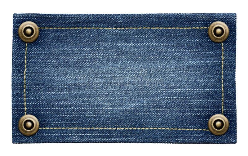 Φορεμένη μπλε ετικέττα τζιν τζιν στοκ εικόνα