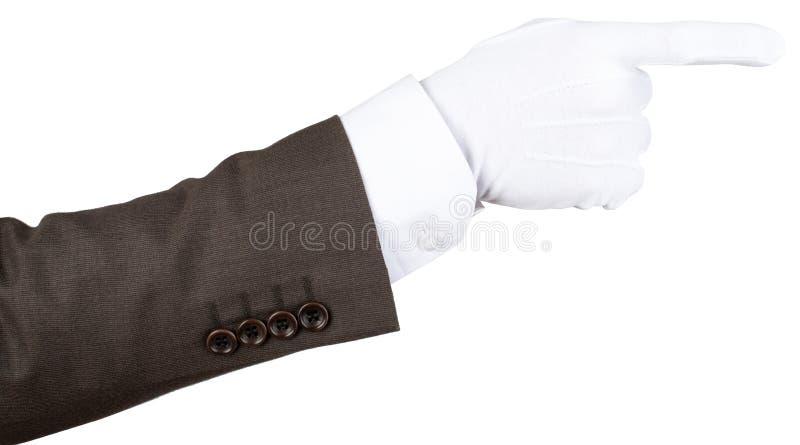 Φορημένη γάντια υπόδειξη χεριών οικονόμου στοκ φωτογραφίες
