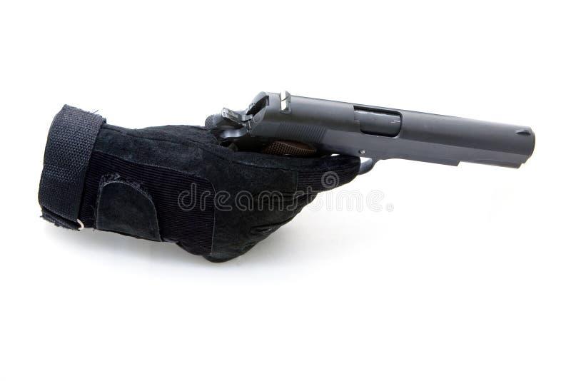 φορημένο γάντια χέρι πυροβό&lam στοκ φωτογραφία με δικαίωμα ελεύθερης χρήσης