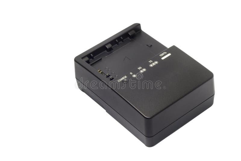 Φορτιστής μπαταριών ψηφιακών κάμερα χωρίς εμπορικό σήμα που απομονώνεται στο άσπρο υπόβαθρο στοκ εικόνα με δικαίωμα ελεύθερης χρήσης