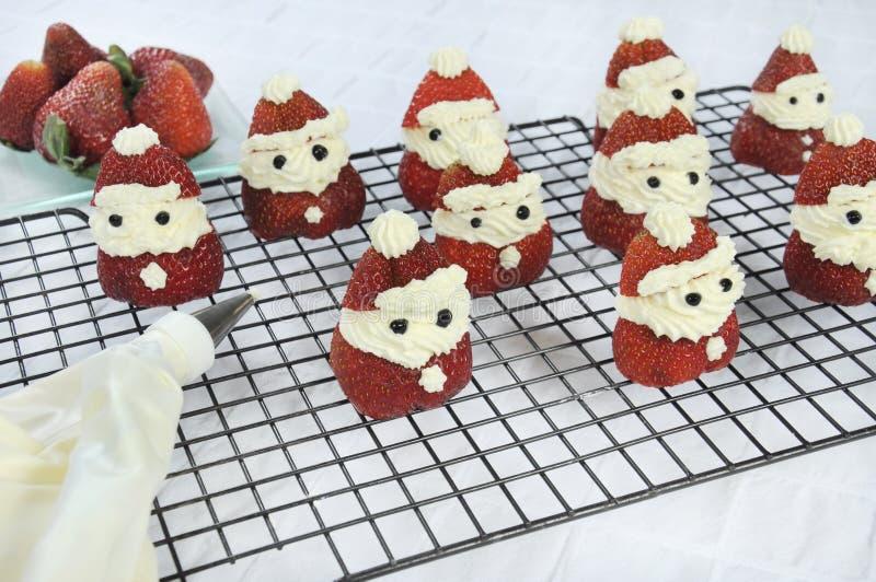 Φράουλα Santas διακοπών Χριστουγέννων στοκ εικόνα