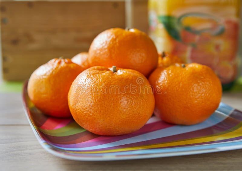 Φρέσκα tangerines, πυροβολισμός στο natura στοκ φωτογραφία