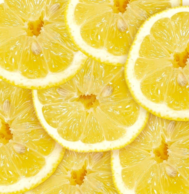 Φρέσκες φέτες λεμονιών Υπόβαθρο με τις φρέσκες φέτες των λεμονιών στοκ εικόνες