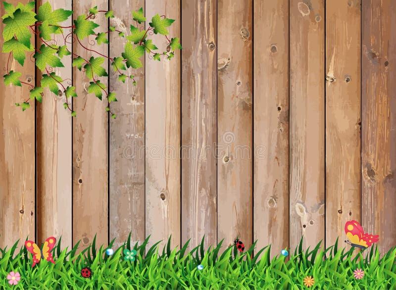 Φρέσκια πράσινη χλόη άνοιξη με το φυτό φύλλων πέρα από τον ξύλινο φράκτη ελεύθερη απεικόνιση δικαιώματος