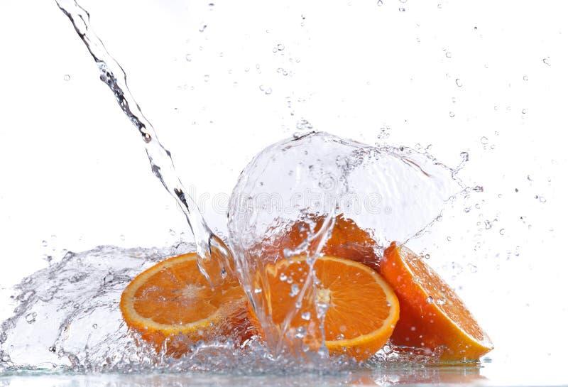 φρέσκο πορτοκαλί ύδωρ παφλασμών στοκ φωτογραφίες