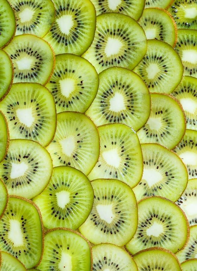 Φρέσκο υπόβαθρο kiwifruit ο κύκλος τεμαχίζει κοντά επάνω στοκ εικόνα με δικαίωμα ελεύθερης χρήσης