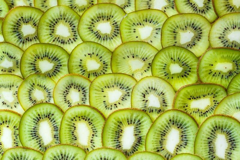 Φρέσκο υπόβαθρο kiwifruit ο κύκλος τεμαχίζει κοντά επάνω στοκ φωτογραφία