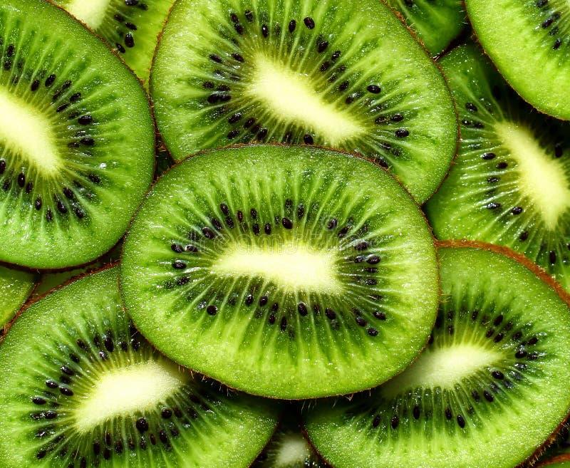 Φρέσκο υπόβαθρο kiwifruit στρογγυλές φέτες στοκ εικόνες