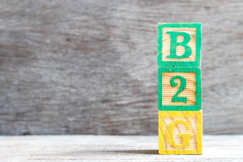 Φραγμός χρώματος στη σύντμηση λέξης b2g της επιχείρησης στην κυβέρνηση στο ξύλινο υπόβαθρο στοκ φωτογραφίες