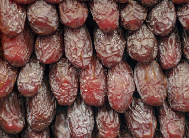 Φρούτα ημερομηνίας που παρατάσσονται διαδοχικά στοκ φωτογραφίες