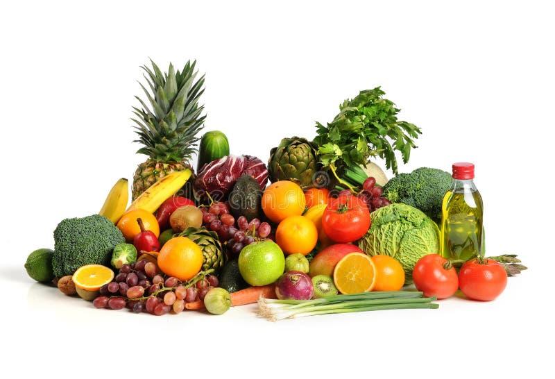 Φρούτα και λαχανικά με το ελαιόλαδο στοκ φωτογραφία