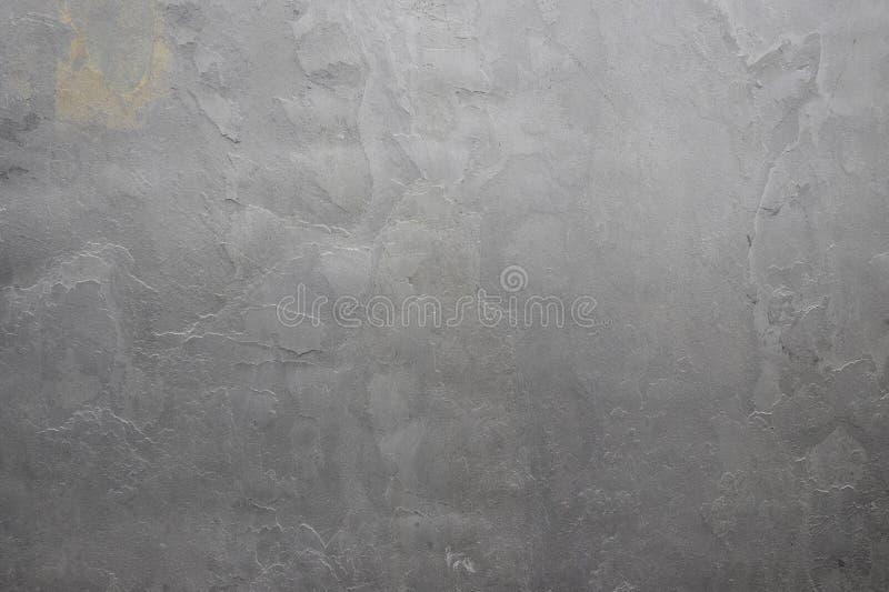 Φυσική γκρίζα ανακούφιση σύστασης στόκων Ο τοίχος αποτελείται από το σκυρόδεμα, η επιφάνεια είναι κατασκευασμένη στοκ φωτογραφία με δικαίωμα ελεύθερης χρήσης