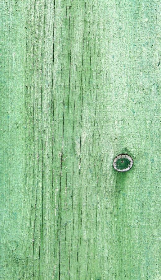 Φυσικό ξεπερασμένο ξύλινο υπόβαθρο σανίδων Παλαιός που χρωματίζεται σε πράσινο στοκ φωτογραφία