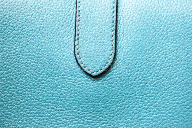 Φυσικό υπόβαθρο τσαντών δέρματος μπλε στοκ φωτογραφία