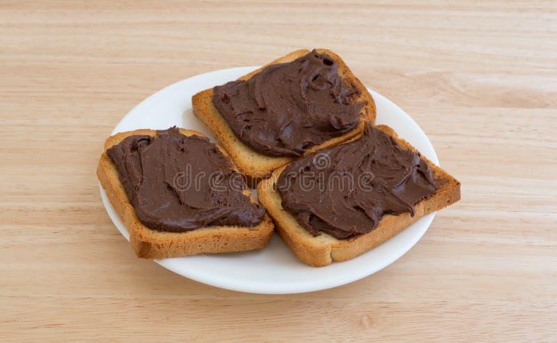 Φυστικοβούτυρο σοκολάτας στη σκληρή επιτραπέζια κορυφή φρυγανιάς στοκ φωτογραφία με δικαίωμα ελεύθερης χρήσης