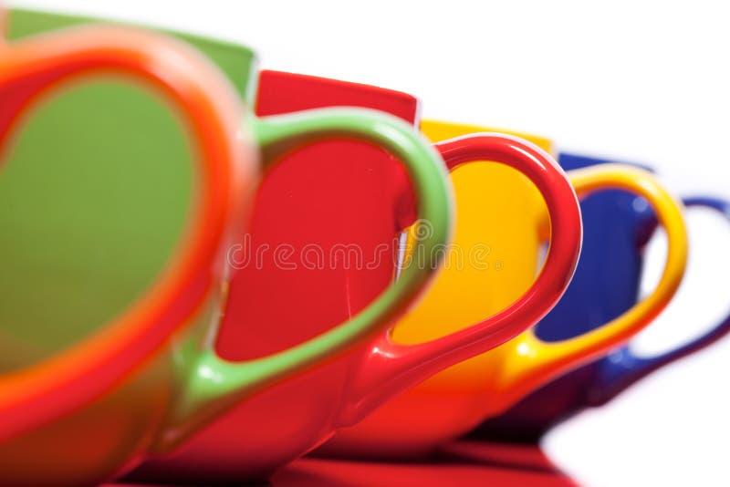 φωτεινά φλυτζάνια χρώματο&sig στοκ εικόνες