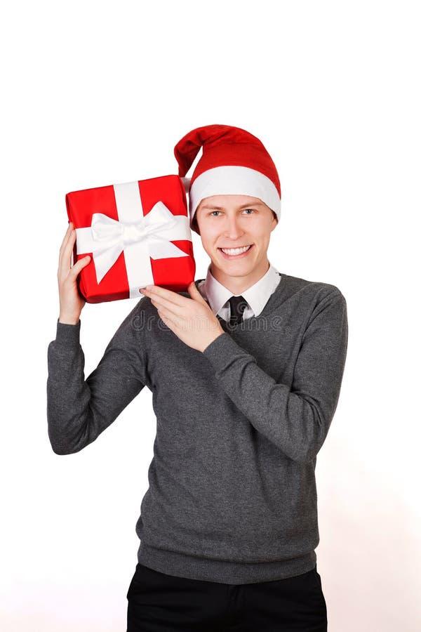 Φωτεινή εικόνα του όμορφου ατόμου που φορά το καπέλο Santa στοκ φωτογραφίες