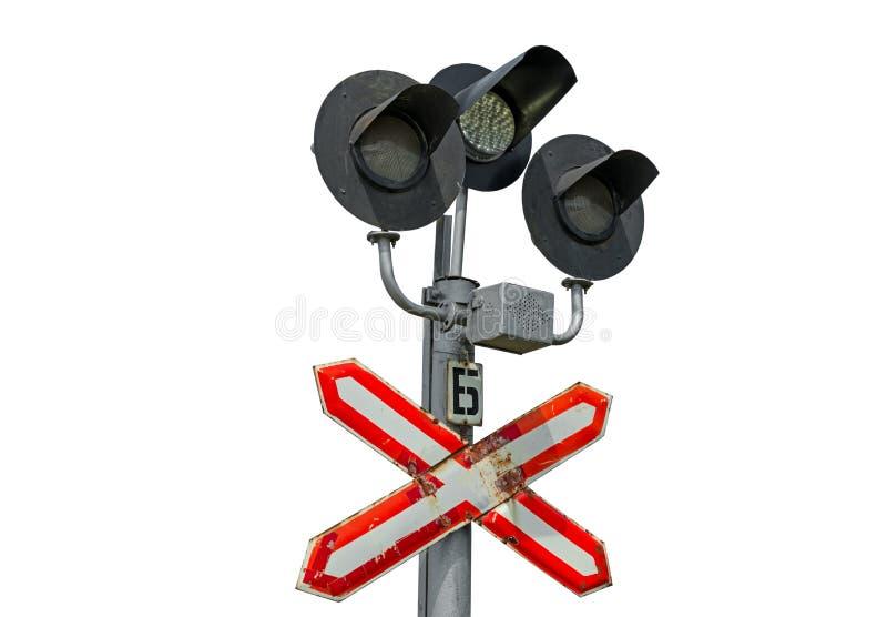 Φωτεινοί σηματοδότες σε έναν σιδηρόδρομο crossingon στο λευκό στοκ εικόνες